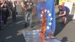 latvians_burn_eu_flag_in_protest_at_euro_entry